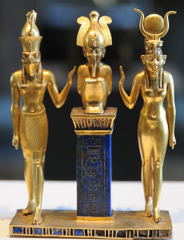 Osiris flanked by Horus and Isis