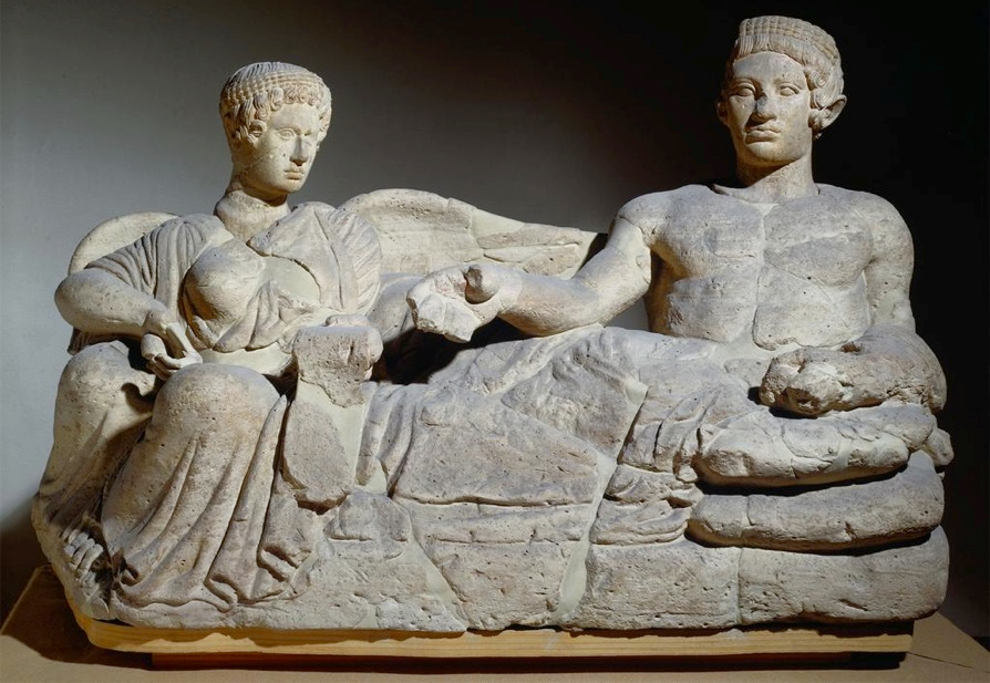 "Youth and demon of death cinerary container, early 4th century BCE. Stone (pietra fetida), length 47""."